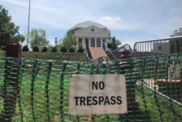 """At University of Virginia, """"no trespass"""" signs and barricades surround the rotunda ahead of a Saturday morning """"reflection and renewal"""" university event with tight security and planned protests on Grounds. (WTOP/Max Smith)"""