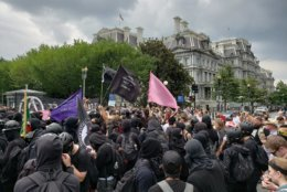 """Anti-Fascists demonstrating on Pennsylvania Avenue during Sunday's """"Unite the Right 2"""" rally and counterrallies. (Courtesy Wilson Dizard)"""