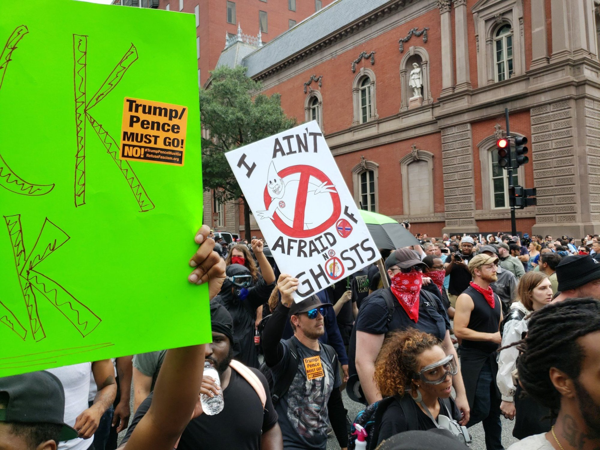 """A counterprotester holds a sign reading """"I ain't afraid of no ghosts"""" during the """"Unite the Right 2"""" in Washington, D.C. (Courtesy Wilson Dizard)"""