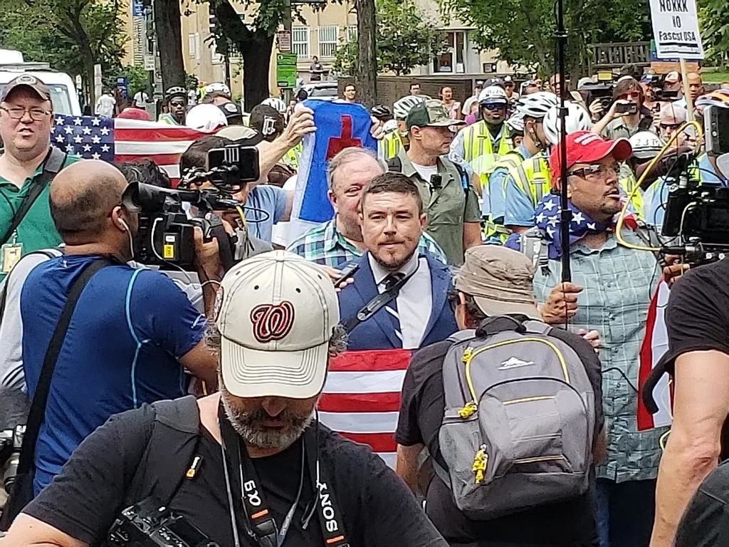 Kessler marches with supporters and police escorts toward Layafatte Square. (Courtesy Wilson Dizard)