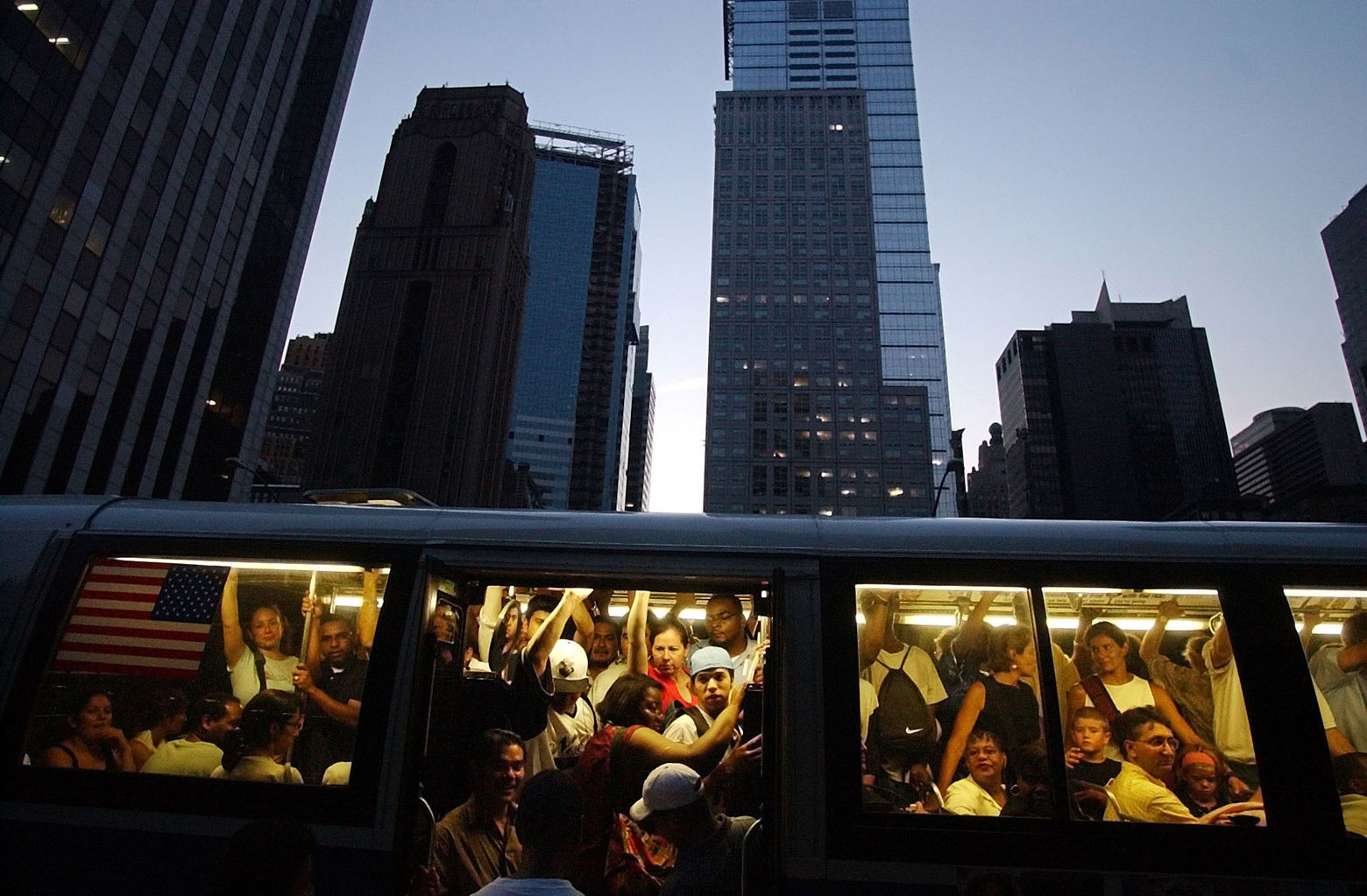 ** FILE **People try to board the back of a crowded New York bus during the blackout that left U.S. and Canadian cities in the dark in this Aug. 14, 2003, file photo. A year after the nation's worst ever blackout, utilities have made improvements and New York has spent millions of dollars on new high-tech gadgets to avert the chaos that followed. (AP Photo/Gregory Bull, File)