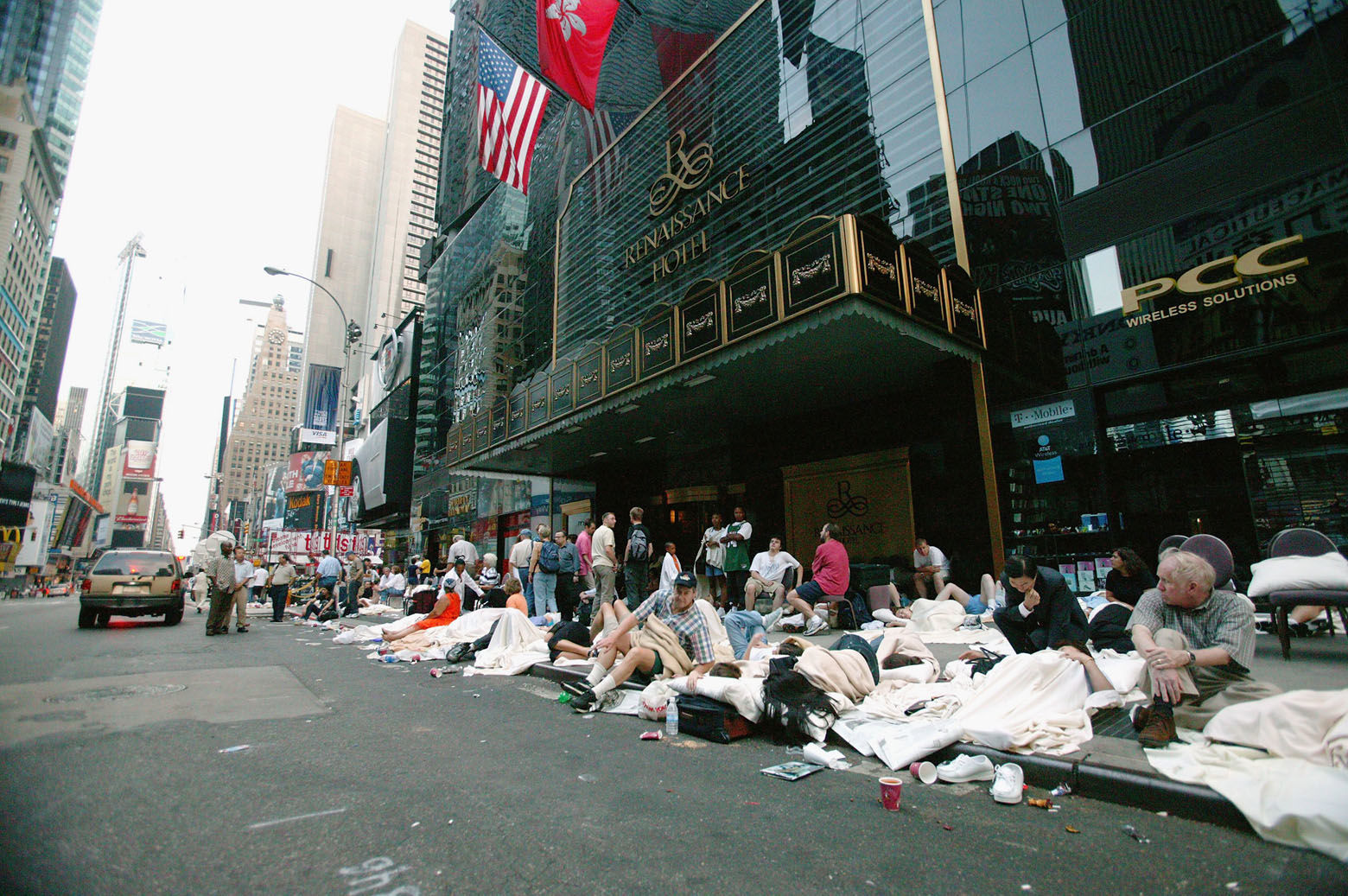 NEW YORK - AUGUST 15:  People sleep on the sidewalk outside the Renaisance Hotel during the east coast blackout August 15, 2003 in New York City. Power is slowly returning to parts of the city after the worst blackout in history. (Photo by Matthew Peyton/Getty Images)