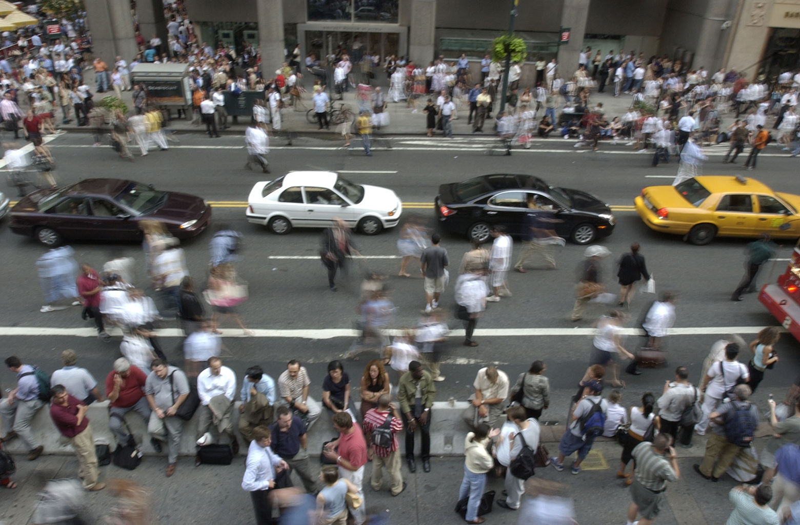 Crowds of people pour onto 42nd Street near Grand Central Station in New York City after a power outage forced them from  surrounding buildings Thursday, Aug. 14, 2003. The outage that hit cities in northeastern United States and Canada, also disrupted cell phone service in New York, the subway system and trains going in and out. (AP Photo/Julie Jacobson)