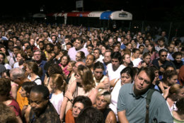 Thousands of commuters wait for a chance to board a ferry from Manhattan to the New Jersey side of the Hudson River, Thursday, Aug. 14, 2003, in New York, after a massive blackout shut down trains and subway lines.  (AP Photo/Julie Jacobson)