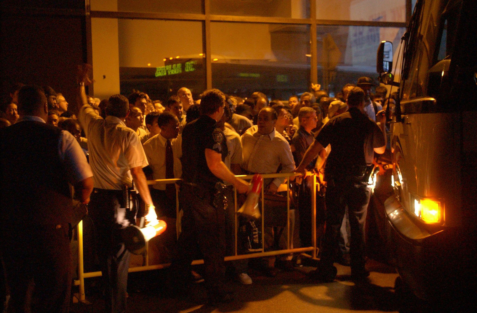 Crowds line up for buses at Port Authority bus terminal in New York during a massive power outage Thursday, Aug. 14, 2003, that stretched from New York to Detroit and into Canada. (AP Photo/Christie Johnston)