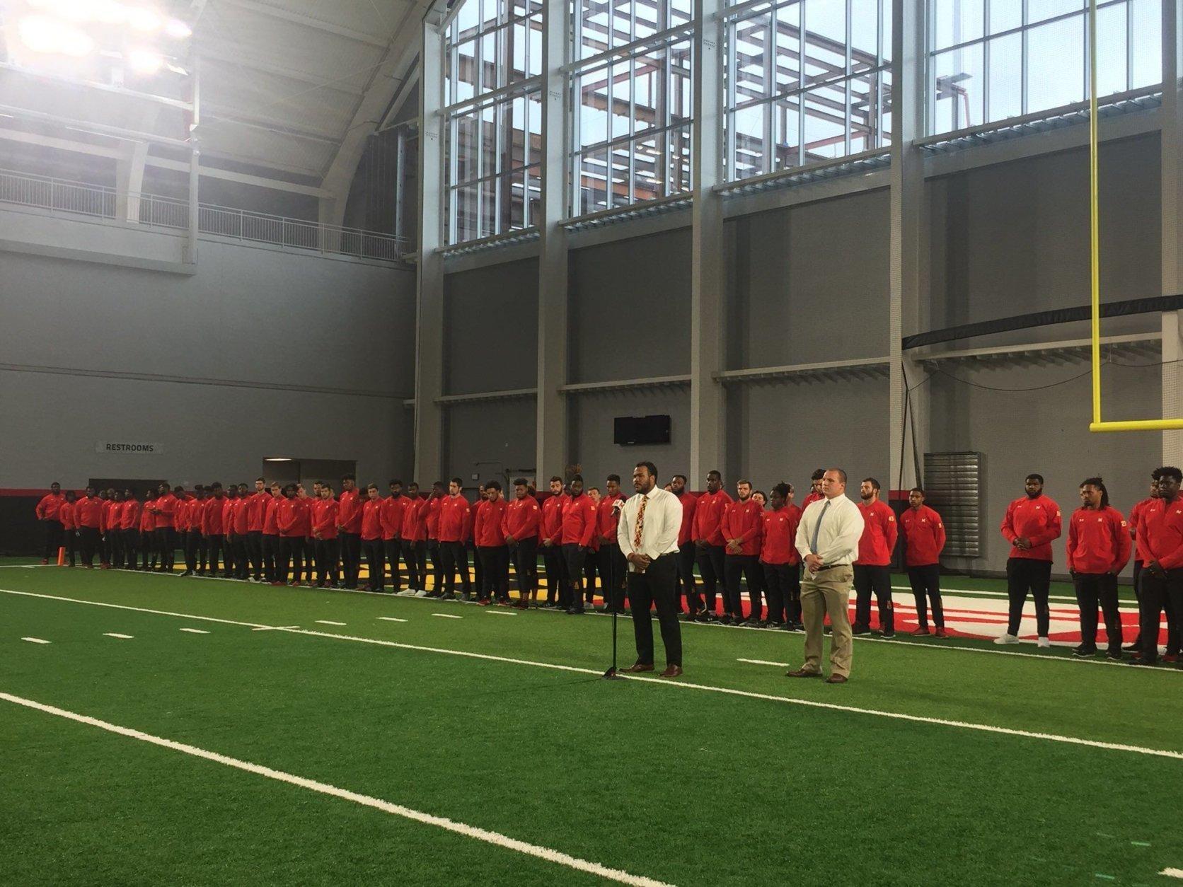 University of Maryland football players honor Jordan McNair by wearing his #79 on their helmets, encasing his locker in glass. (WTOP/Melissa Howell)