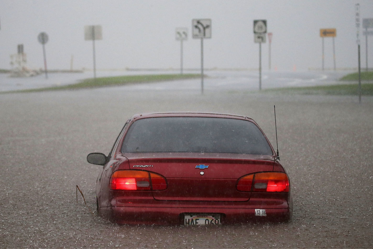 HILO, HI - AUGUST 23:  A car is stuck partially submerged in floodwaters from Hurricane Lane rainfall on the Big Island on August 23, 2018 in Hilo, Hawaii. Hurricane Lane has brought more than a foot of rain to some parts of the Big Island which is under a flash flood warning. (Photo by Mario Tama/Getty Images)