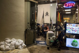 HONOLULU, HI - AUGUST 23: 2018   Furusato restaurant in the Hyatt Regency stayed open late but prepared sand bags to protect their Kalakaua Avenue store from flooding as Hurricane Lane approaches Waikiki Beach on Thursday, August 23, 2018 in Honolulu, Hi.   (Photo by Kat Wade/Getty Images)