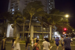 HONOLULU, HI - AUGUST 23: 2018   Fewer than the normal amount of nightly tourists stroll the streets of Waikiki as Hurricane Lane approaches Waikiki Beach on Thursday, August 23, 2018 in Honolulu, Hi.   (Photo by Kat Wade/Getty Images)