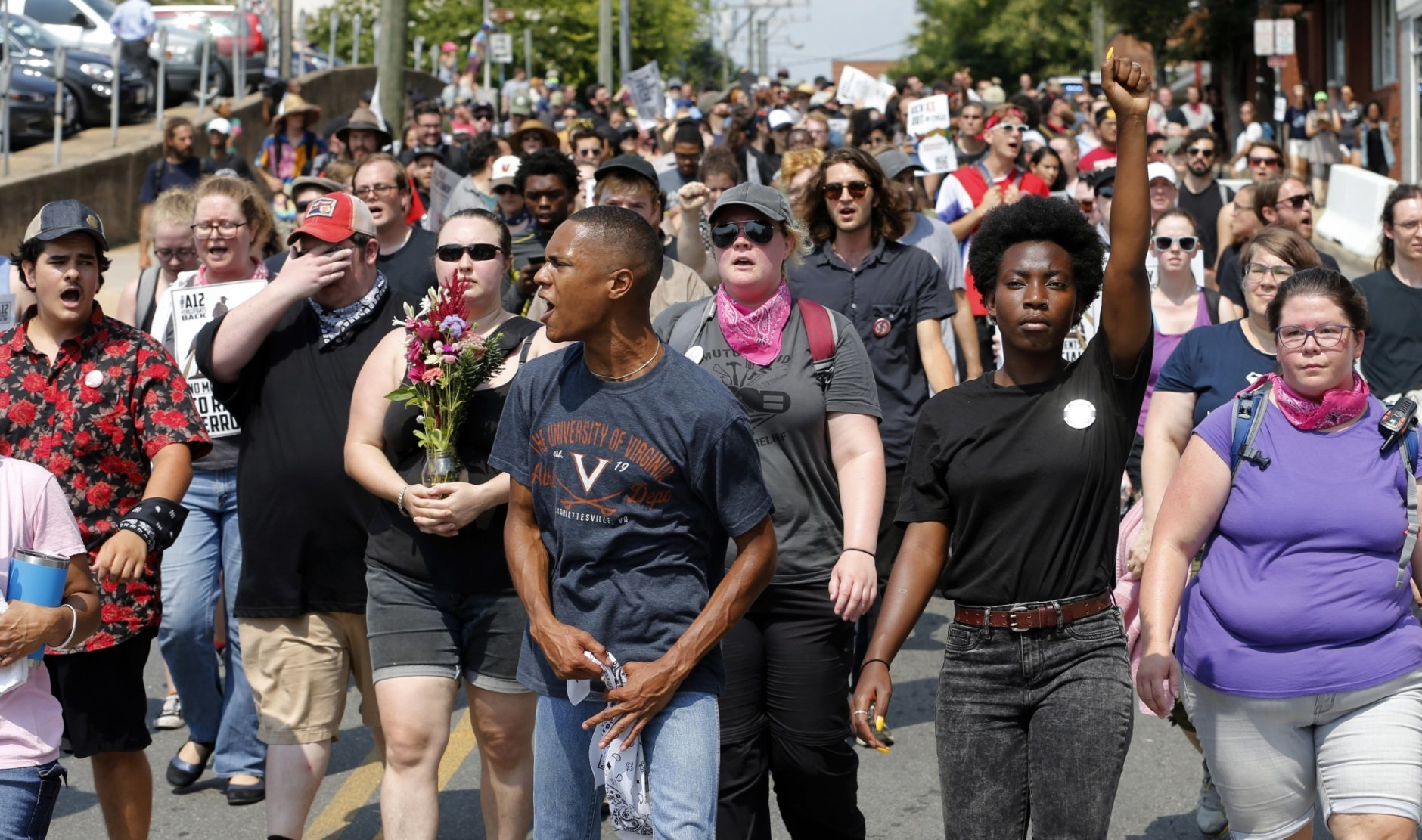 Demonstrators against racism march along city streets as they mark the anniversary of last year's Unite the Right rally in Charlottesville, Va., Sunday, Aug. 12, 2018. (AP Photo/Steve Helber)