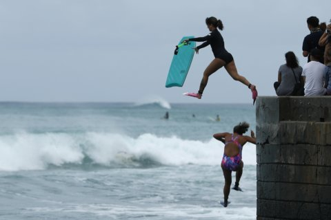 Hawaii emerges from threat as storm veers away from islands