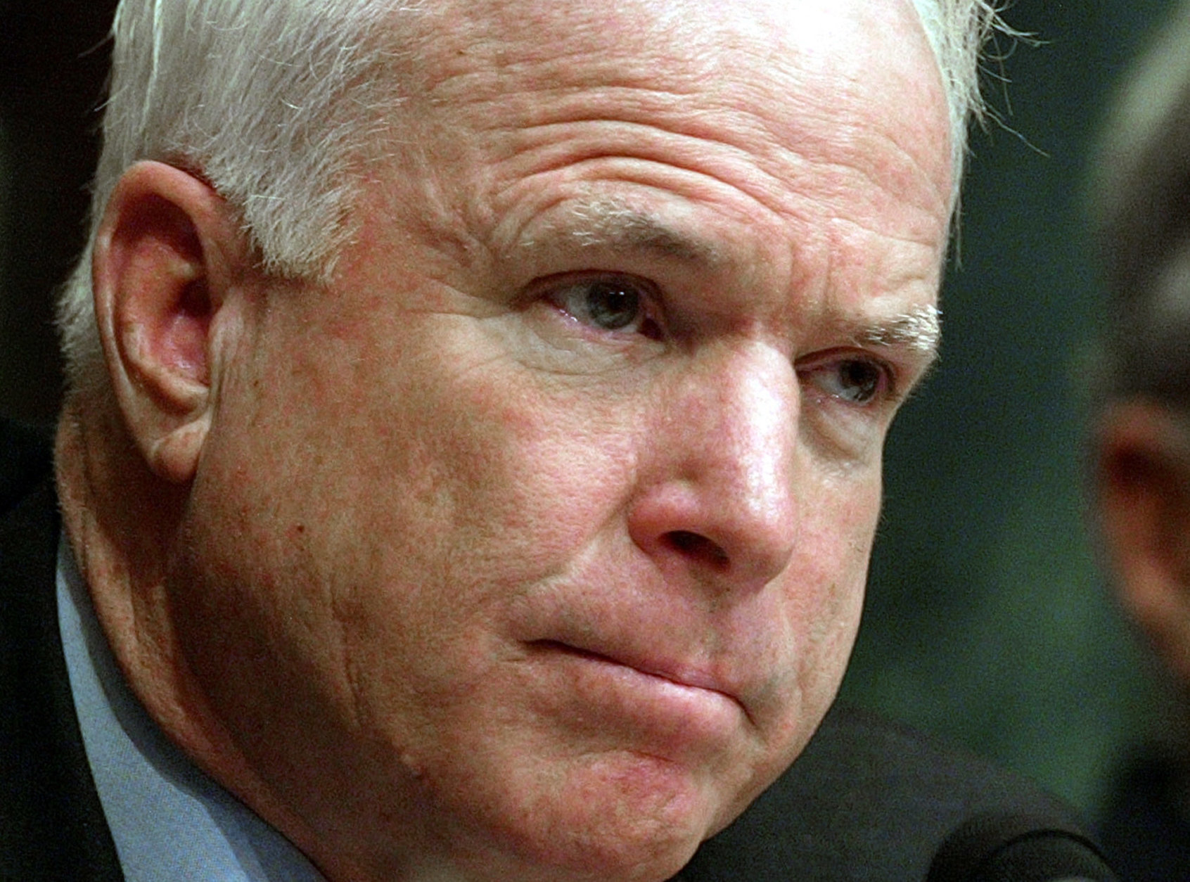Senate Armed Services committee member Sen. John McCain, R-Ariz., listens to testimony Tuesday, May 11, 2004, in Washington, dealing with abuses to prisoners at Abu Ghraib, a U.S.-run prison complex near Baghdad, Iraq  (AP Photo/Ron Edmonds)