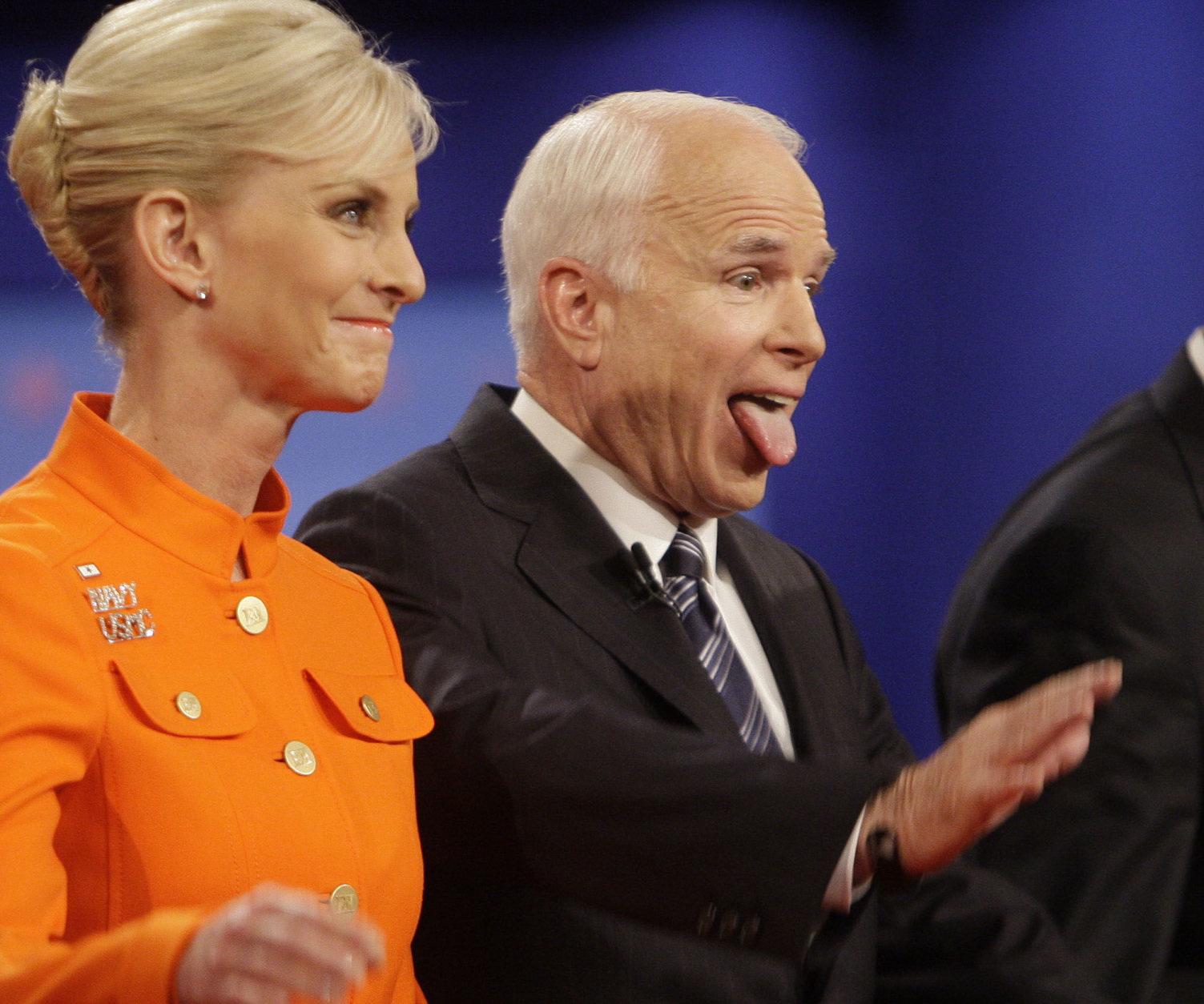 Republican presidential candidate Sen. John McCain, R-Ariz., right, joined by wife Cindy McCain, reacts to the crowd following his presidential debate against Democratic presidential candidate Sen. Barack Obama, D-Ill., at Hofstra University in Hempstead, N.Y., Wednesday, Oct. 15, 2008. (AP Photo/Seth Wenig)