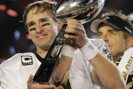 New Orleans Saints quarterback Drew Brees (9) celebrates with the Vince Lombardi Trophy after the Saints' 31-17 win over the Indianapolis Colts in the NFL Super Bowl XLIV football game in Miami, Sunday, Feb. 7, 2010. (AP Photo/Julie Jacobson)