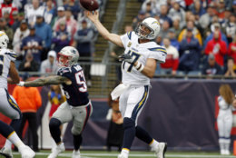 Los Angeles Chargers quarterback Philip Rivers (17) passes under pressure from New England Patriots defensive end Cassius Marsh (55) during the first half of an NFL football game, Sunday, Oct. 29, 2017, in Foxborough, Mass. (AP Photo/Michael Dwyer)