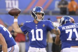 New York Giants quarterback Eli Manning (10) throws a pass during the first half of a preseason NFL football game against the Cleveland Browns Thursday, Aug. 9, 2018, in East Rutherford, N.J. (AP Photo/Bill Kostroun)