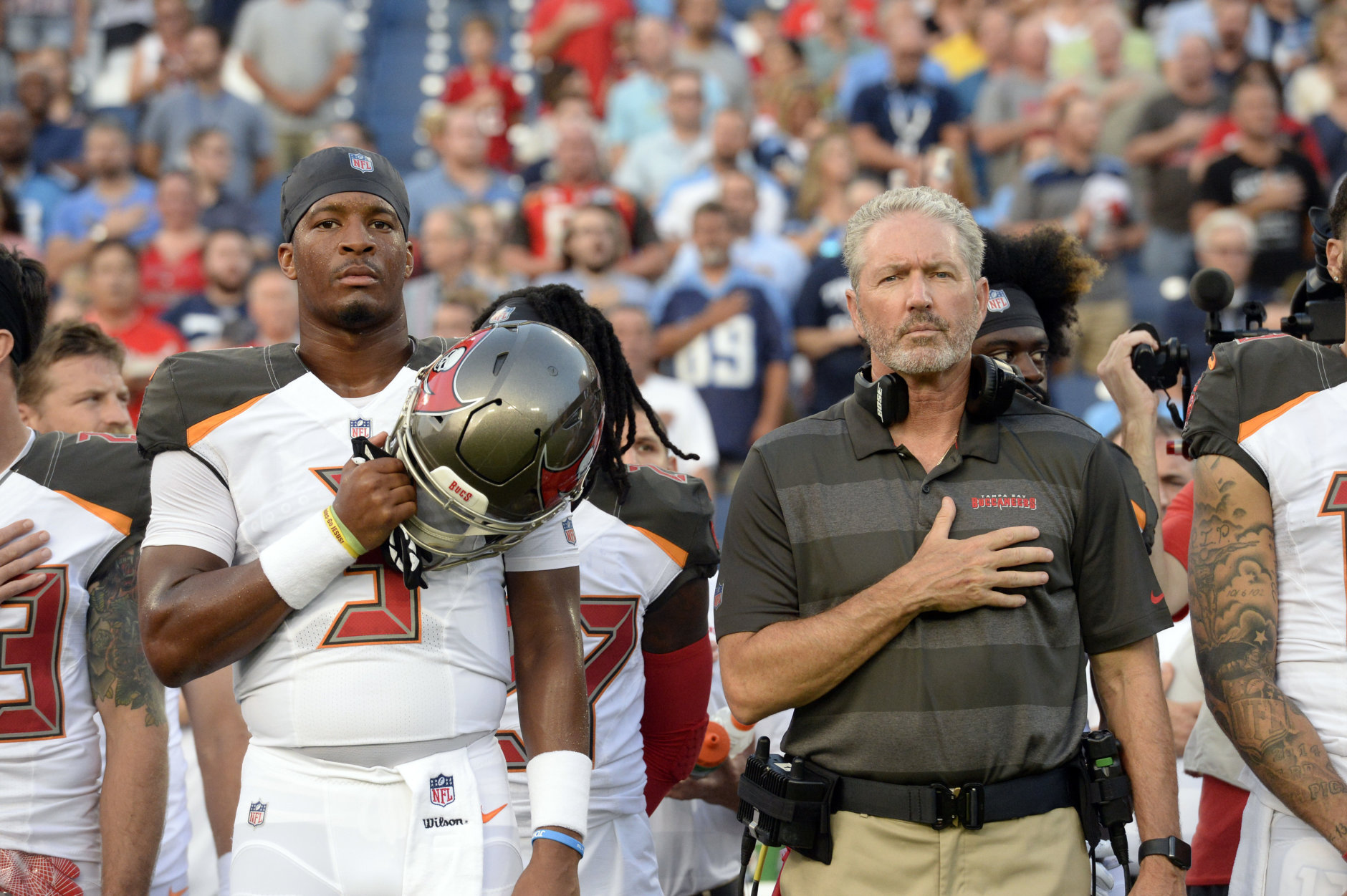 Tampa Bay Buccaneers head coach Dirk Koetter and quarterback Jameis Winston (3) stand for the national anthem before a preseason NFL football game against the Tennessee Titans Saturday, Aug. 18, 2018, in Nashville, Tenn. (AP Photo/Mark Zaleski))
