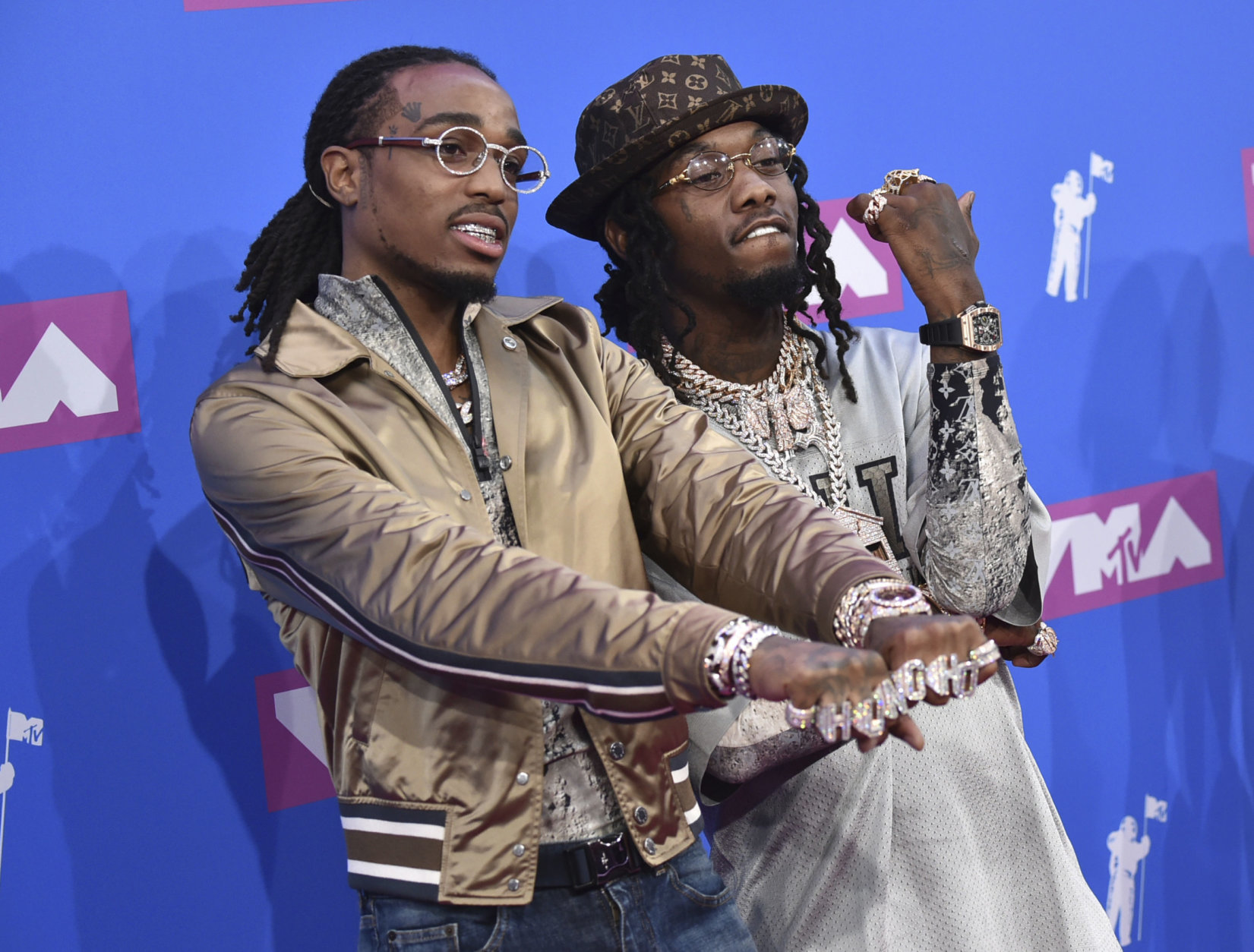 Offset, left, and Quavo of Migos arrive at the MTV Video Music Awards at Radio City Music Hall on Monday, Aug. 20, 2018, in New York. (Photo by Evan Agostini/Invision/AP)