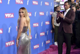 Alex Rodriguez, right, photographs Jennifer Lopez as they arrive at the MTV Video Music Awards at Radio City Music Hall on Monday, Aug. 20, 2018, in New York. (Photo by Evan Agostini/Invision/AP)