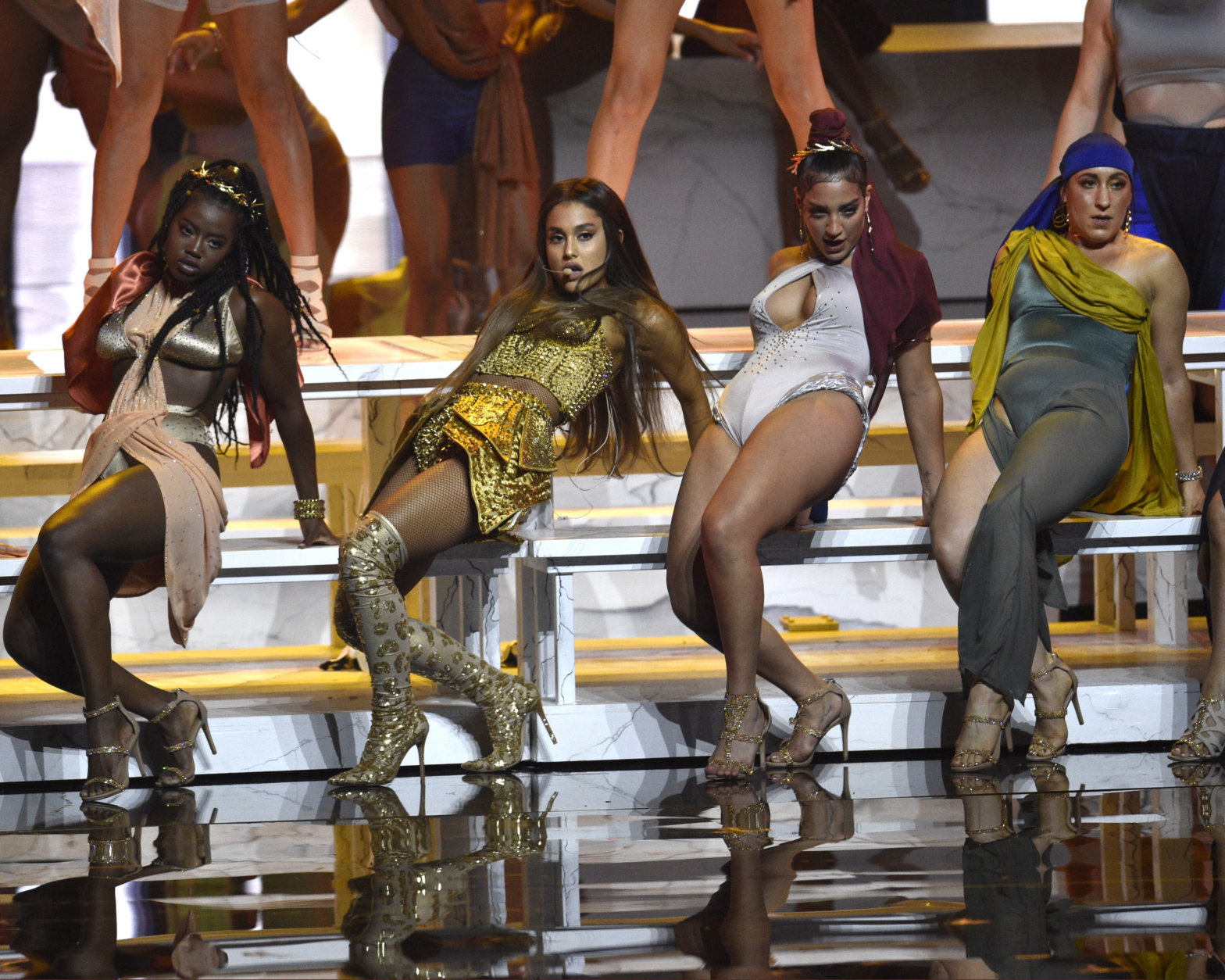 "Ariana Grande, second left, performs ""God is a woman"" at the MTV Video Music Awards at Radio City Music Hall on Monday, Aug. 20, 2018, in New York. (Photo by Chris Pizzello/Invision/AP)"
