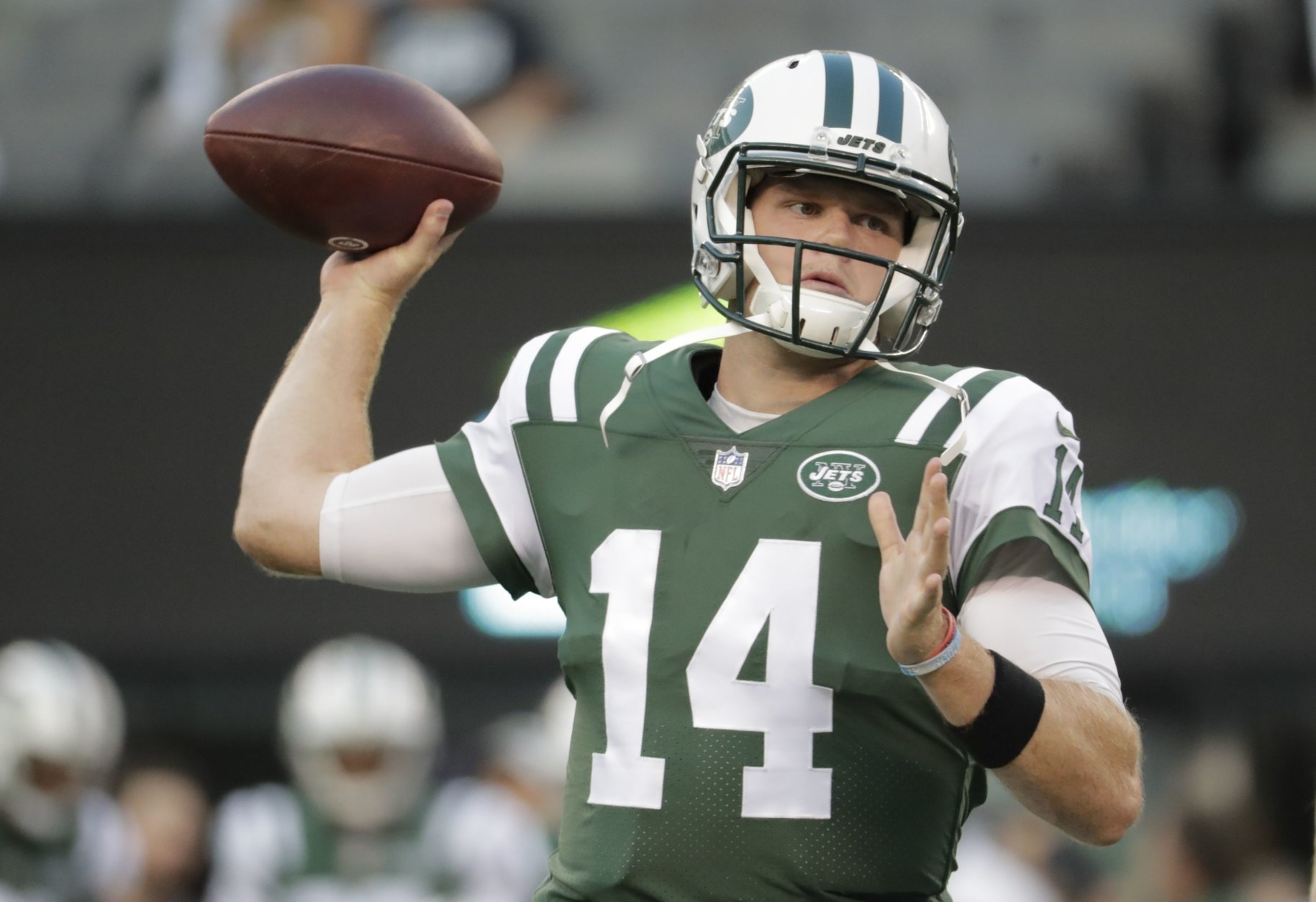 New York Jets quarterback Sam Darnold (14) warms up before an NFL football game against the New York Giants, Friday, Aug. 24, 2018, in East Rutherford, N.J. (AP Photo/Julio Cortez)