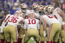 San Francisco 49ers quarterback Jimmy Garoppolo (10) huddles his offense during the first half of an NFL preseason football game against the Indianapolis Colts in Indianapolis, Saturday, Aug. 25, 2018. (AP Photo/Michael Conroy)