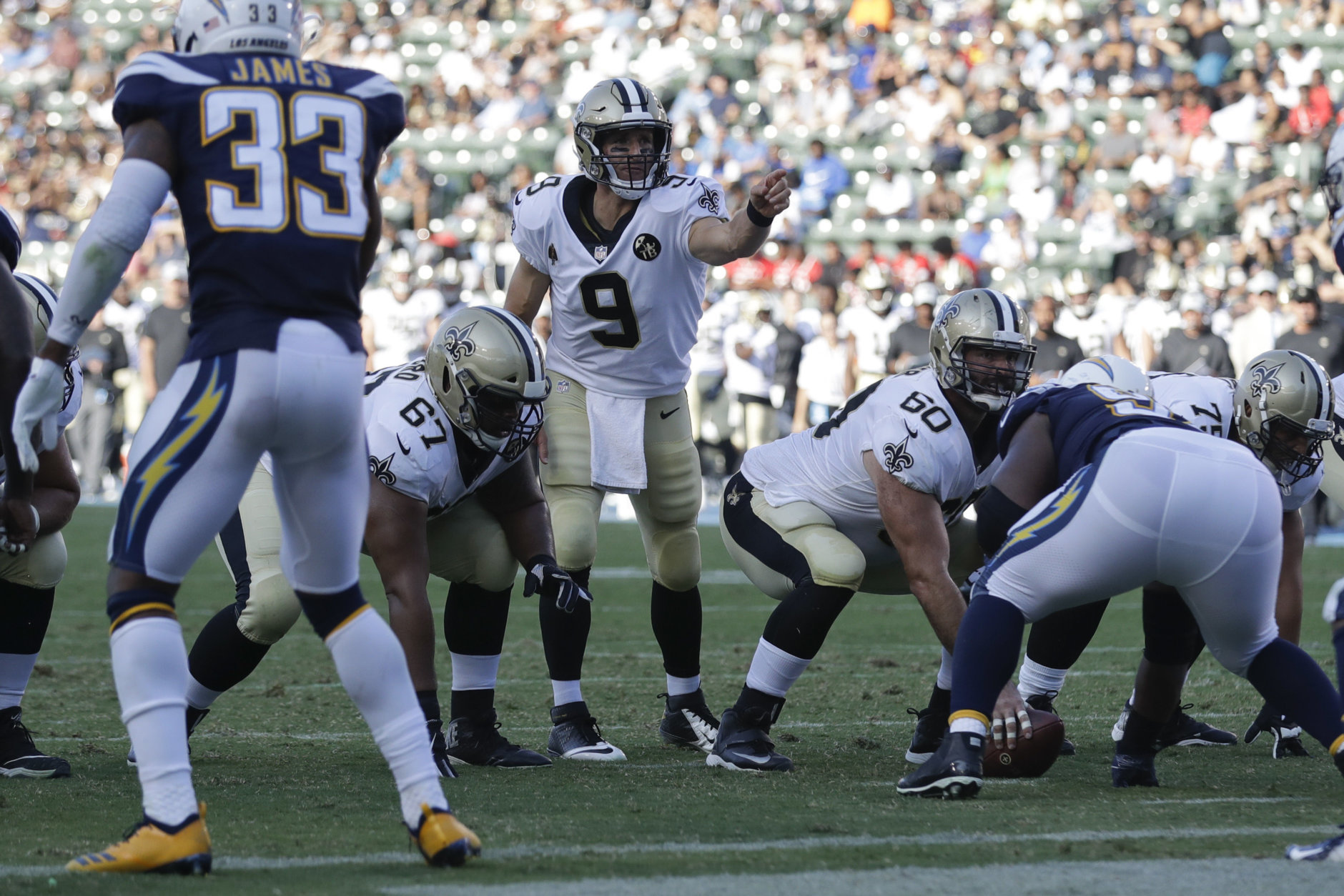 New Orleans Saints quarterback Drew Brees motions before a play during the first half of an NFL preseason football game against the Los Angeles Chargers Saturday, Aug. 25, 2018, in Carson, Calif. (AP Photo/Marcio Jose Sanchez)