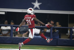 Arizona Cardinals defensive back Patrick Peterson (21) scores a touchdown after making an interception against the Dallas Cowboys during the first half of a preseason NFL football game in Arlington, Texas, Sunday, Aug. 26, 2018. (AP Photo/Michael Ainsworth)