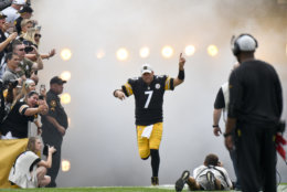 In this photo from Aug. 25, 2018, Pittsburgh Steelers quarterback Ben Roethlisberger (7) takes the field as fans and head coach Mike Tomlin, right, watch before an NFL preseason football game against the Tennessee Titans in Pittsburgh. Roethlisberger feels rejuvenated entering his 15th season. Yet even as he considers extending his career beyond 2019, he is well aware that time is of the essence for the two-time defending AFC North champions.(AP Photo/Don Wright)