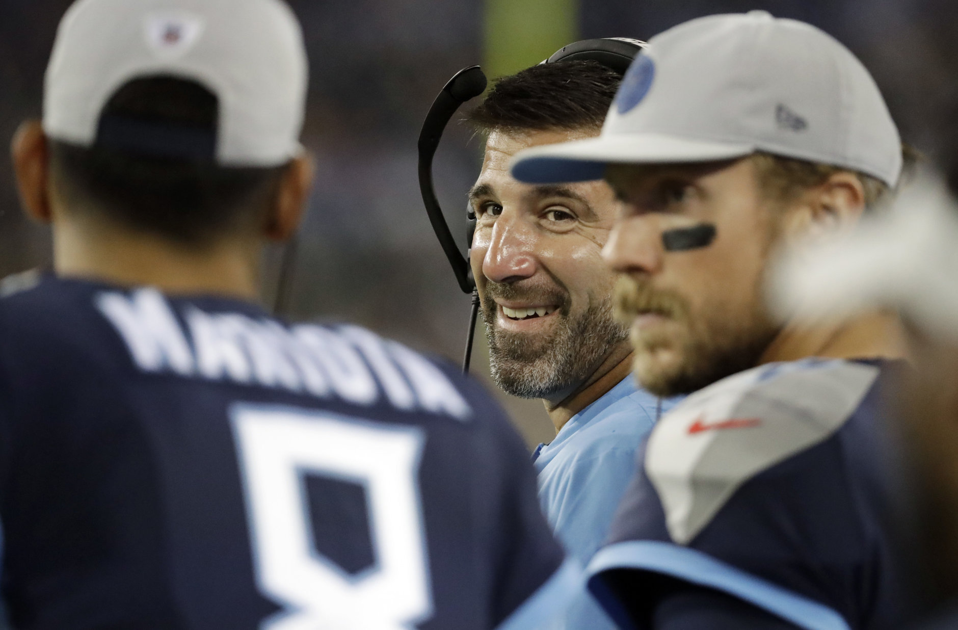Tennessee Titans head coach Mike Vrabel, center, talks with quarterbacks Marcus Mariota (8) and Blaine Gabbert, right, in the first half of a preseason NFL football game against the Minnesota Vikings Thursday, Aug. 30, 2018, in Nashville, Tenn. (AP Photo/James Kenney)