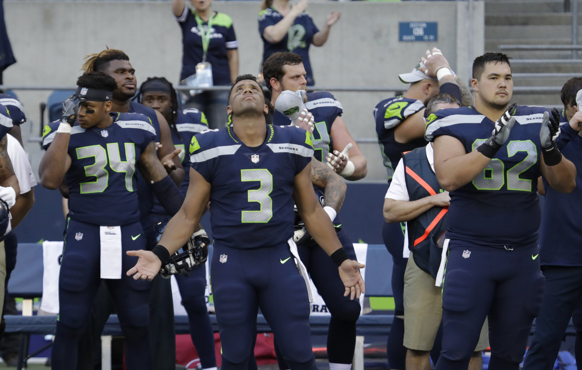 Seattle Seahawks quarterback Russell Wilson (3) gestures as he looks up after the singing of the national anthem before the team's NFL football preseason game against the Oakland Raiders, Thursday, Aug. 30, 2018, in Seattle. (AP Photo/Elaine Thompson)