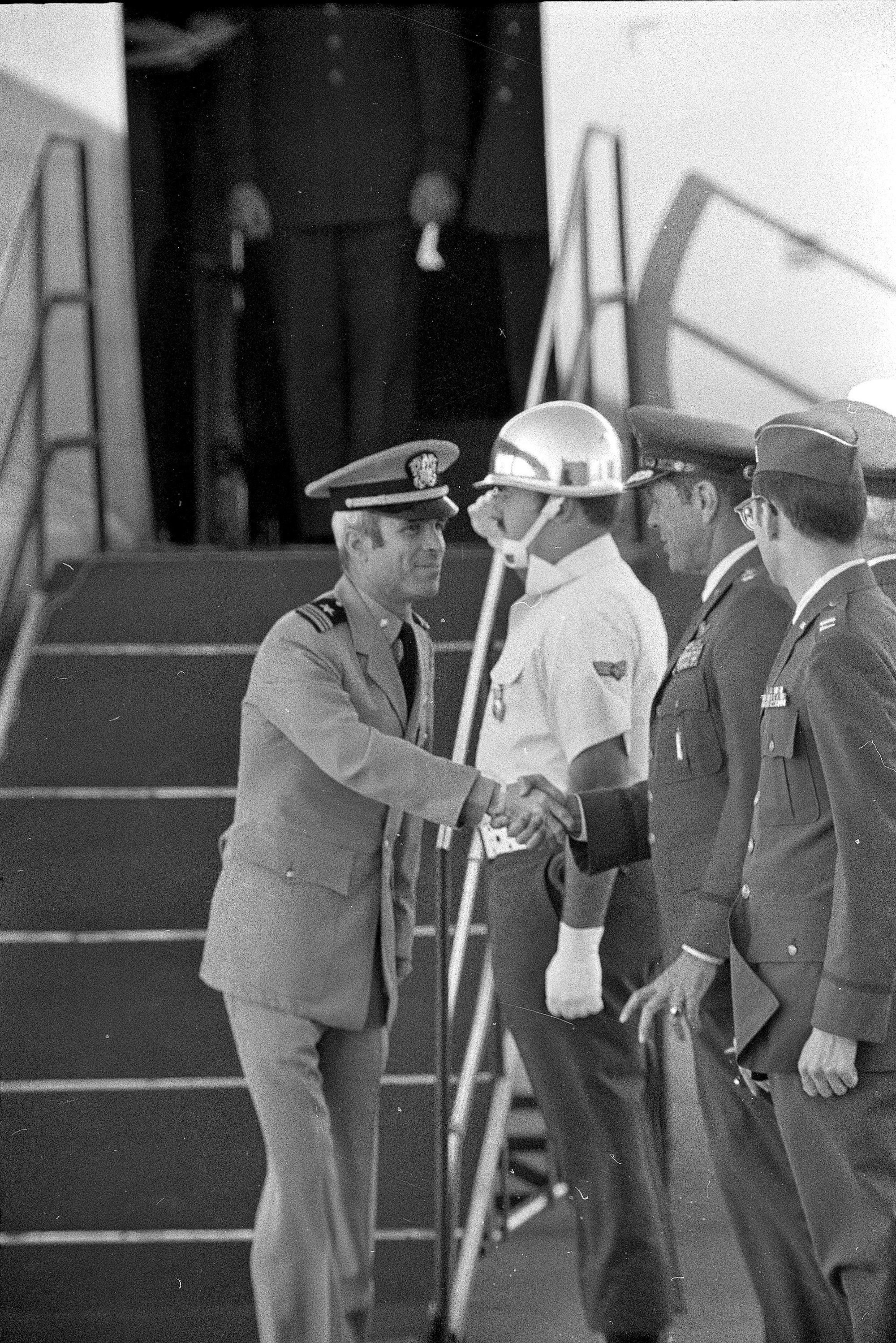 Navy Cmdr. John S. McCain III, a released POW, is greeted by Air Force officers as he deplanes at Maxwell Air Force Base in Alabama on March 17, 1973.  (AP Photo)