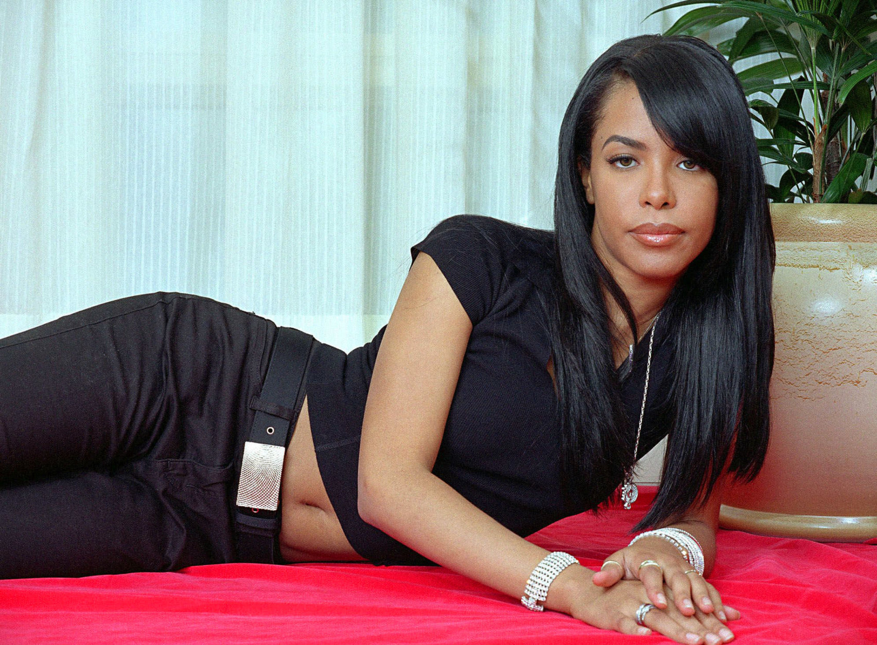 """FILE - This May 9, 2001 file photo shows R&B singer and actress Aaliyah posing for a photo in New York. Recording artist Drake, a huge Aaliyah fan, has announced that he is working on a posthumous album of Aaliyah music, and he's already released the song """"Enough Said"""" featuring himself and the singer, who was killed in a plane crash in 2001. (AP Photo/Jim Cooper, file)"""