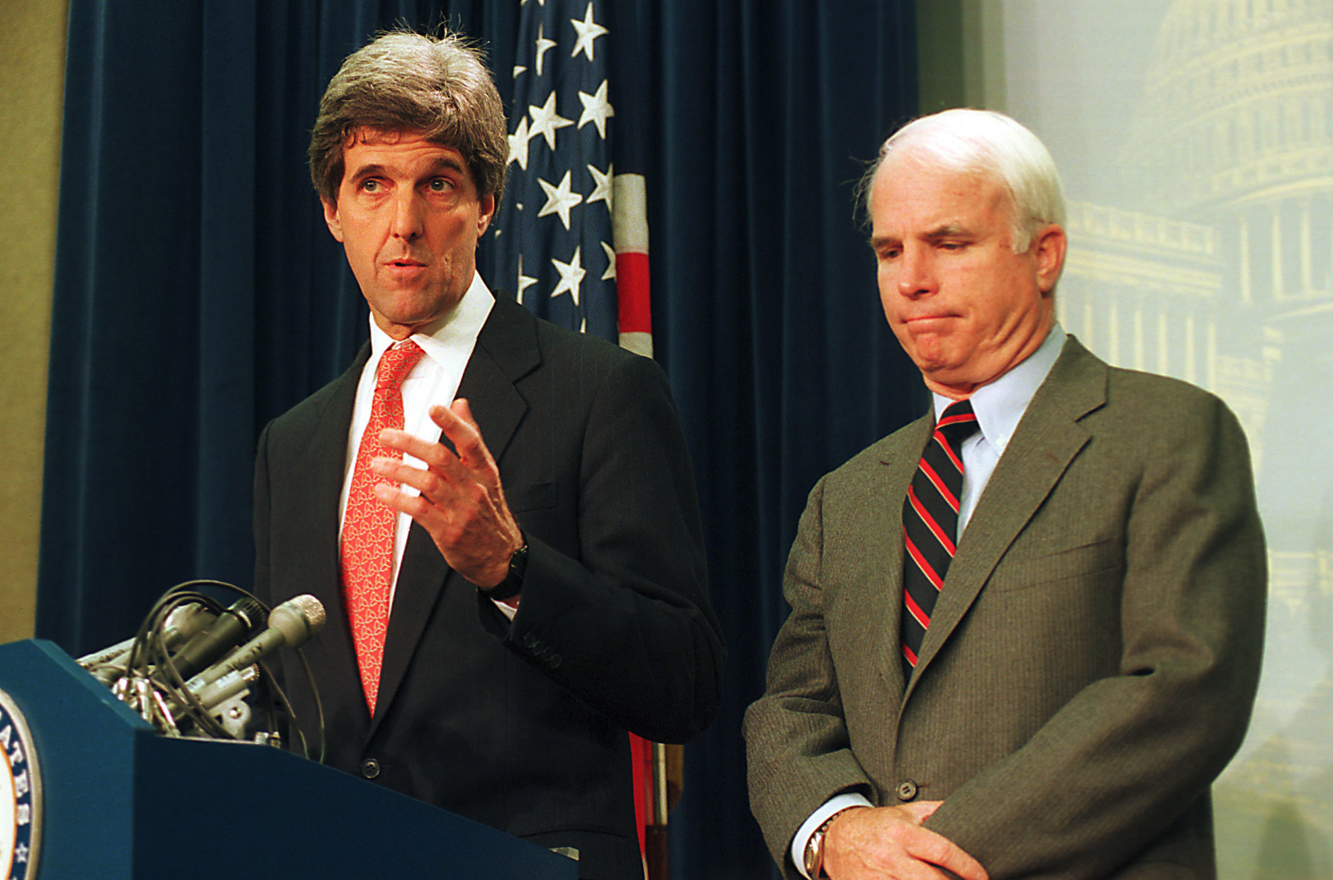 Sen. John Kerry, D-Mass., left, and Sen. John McCain, R-Ariz., meet reporters on Capitol Hill in Washington, D.C., Jan. 27, 1994, after the Senate voted to urge the Clinton administration to lift the 19-year-old trade embargo against Vietnam.  (AP Photo/John Duricka)