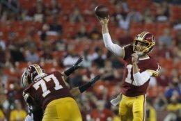 Washington Redskins quarterback Alex Smith throws during the first half of the team's preseason NFL football game against the New York Jets. Thursday, Aug. 16, 2018, in Landover, Md. (AP Photo/Alex Brandon)