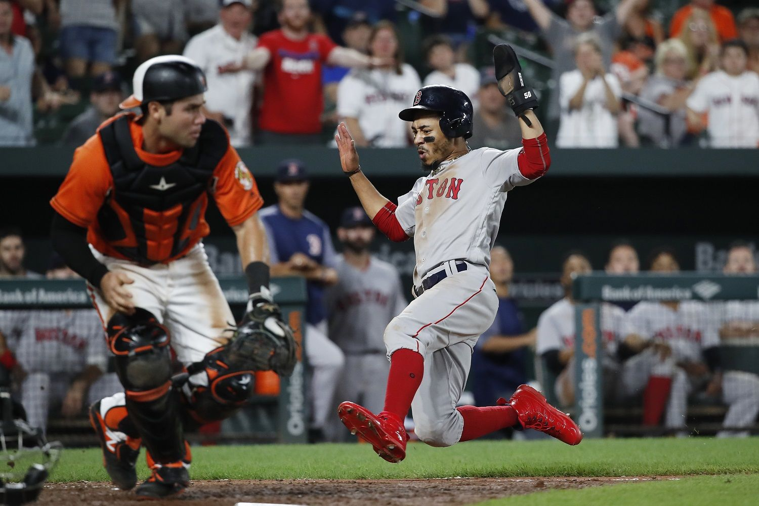 BALTIMORE, MD - AUGUST 11: Mookie Betts #50 of the Boston Red Sox scores a run on a single by Brock Holt #12 (not pictured) in the ninth inning against the Baltimore Orioles during game two of a doubleheader at Oriole Park at Camden Yards on August 11, 2018 in Baltimore, Maryland. (Photo by Patrick McDermott/Getty Images)