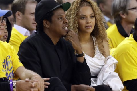 Fan charged after rushing onstage at Beyonce, Jay-Z concert