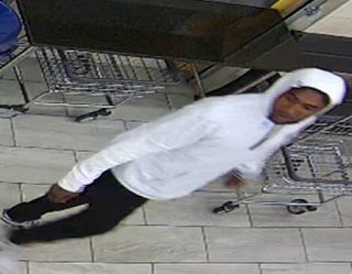 Around 2 a.m. Wednesday, the suspect walked into a laundromat in the 4100 block of Branch Avenue in Temple Hills, Maryland, pulled out a knife and demanded money. The suspect cut an employee on the arm before running out of the store. He did not get any money, Prince George's County police said. (Courtesy Prince George's County police)