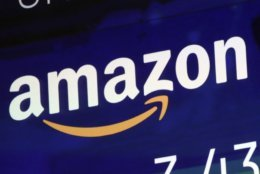 """FILE - In this Friday, July 27, 2018 file photo, the logo for Amazon is displayed on a screen at the Nasdaq MarketSite. Amazon is facing criticism after its British tax bill fell despite a big jump in sales and profits. Records show Amazon U.K. Services Ltd. faced a 2017 tax bill of 4.6 million pounds ($6 million) but paid 1.7 million pounds ($2.2 million), deferring the rest. Its pre-tax profits for the same period were 72.4 million, almost triple the previous year's 24.3 million. Amazon said Friday, Aug. 3 that it pays """"all taxes required in the U.K. and every country where we operate."""" (AP Photo/Richard Drew, file)"""