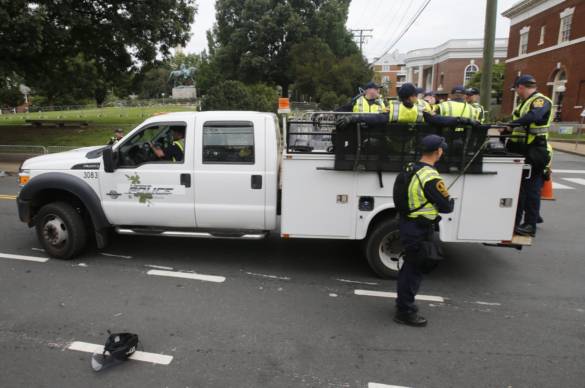 State Police patrol the road in front of Market Street park with the state of Confederate General Robert E. Lee as they lock down the downtown area in anticipation of the anniversary of last year's Unite the Right rally in Charlottesville, Va., Saturday, Aug. 11, 2018. The Governor has declared a state of emergency in Charlottesville. (AP Photo/Steve Helber)