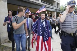 White nationalist Jason Kessler arrives at the Vienna metro station in Vienna, Va., Sunday, Aug. 12, 2018. White nationalists are gathering there to travel to Washington on the first anniversary of their rally in Charlottesville.  (AP Photo/Sait Serkan Gurbuz)