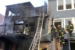 Fire officials said the fire was near the rear porches of the two adjacent town houses when they arrived on the scene. (Courtesy DC Fire and EMS)