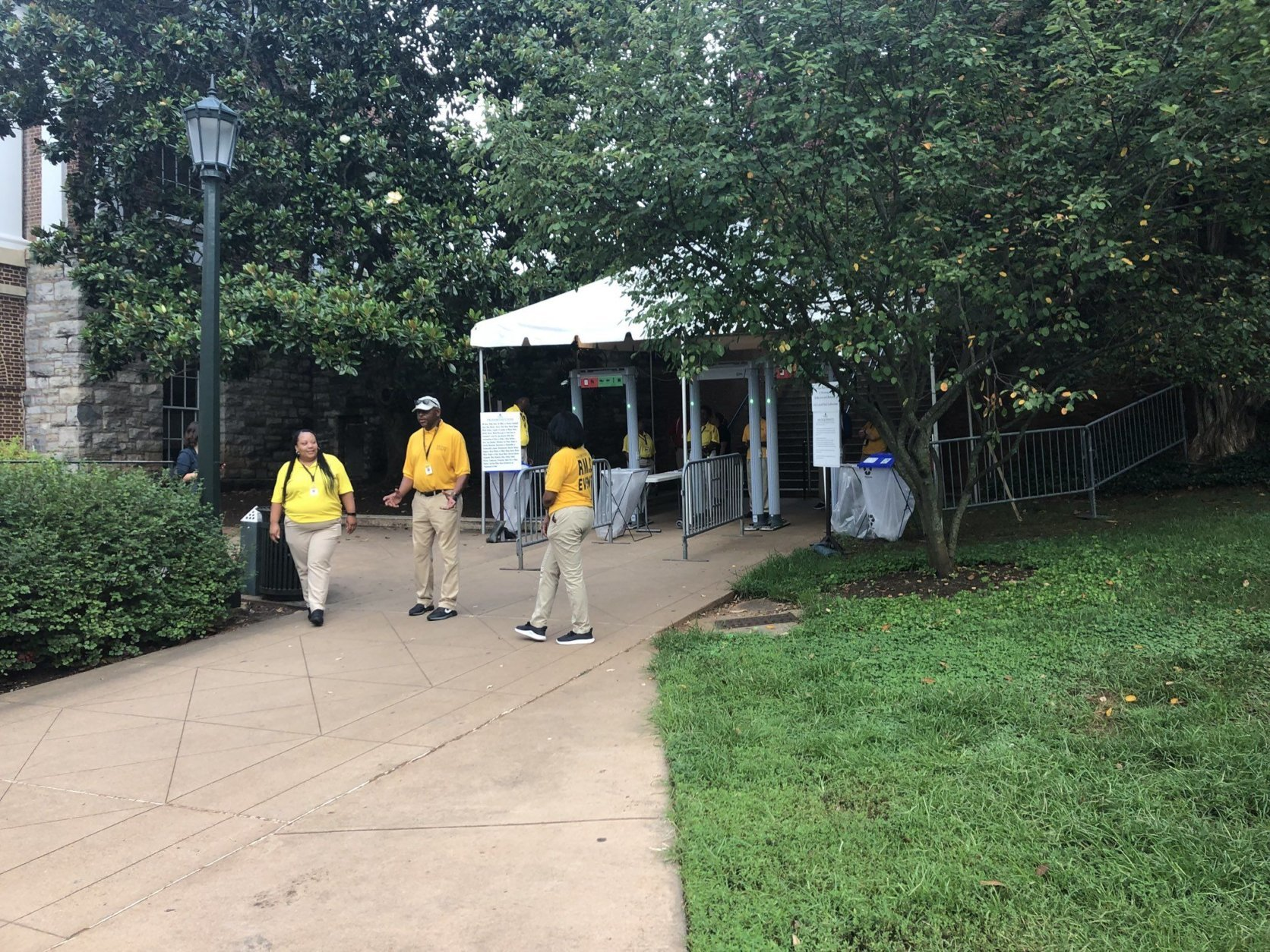 """A security checkpoint is seen near the amphitheater for Saturday morning's """"The Hope that Summons Us"""" event at the University of Virginia. It comes one year after white supremacists marched through the Grounds with tiki torches, and a day before anniversary of Heather Heyer's death. (WTOP/Max Smith)"""