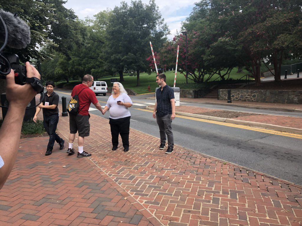 """Heather Heyer's mother, Susan Bro, arrives at the University of Virginia for Saturday morning's """"The Hope that Summons Us"""" event. It comes one year after white supremacists marched through the Grounds with tiki torches, and a day before anniversary of Heyer's death. (WTOP/Max Smith)"""