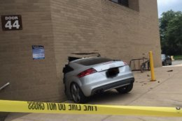 One person is being treated after a car crashed into a wall of Inova Alexandria Hospital Saturday afternoon. (Courtesy Alexandria IAFF)