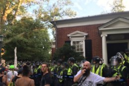 "Attendees moved away from the permit area during the ""Rally for Justice"" at University of Virginia on Saturday, Aug. 11, 2018, drawing concern from law enforcement. (WTOP/Max Smith)"