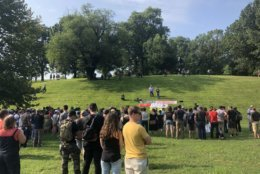 """At a rally in Booker T. Washington Park in Charlottesville, Virginia, a speaker says, """"This is a really big day. They may lock down our city, but they will never lock down our fight."""" (WTOP/Max Smith)"""