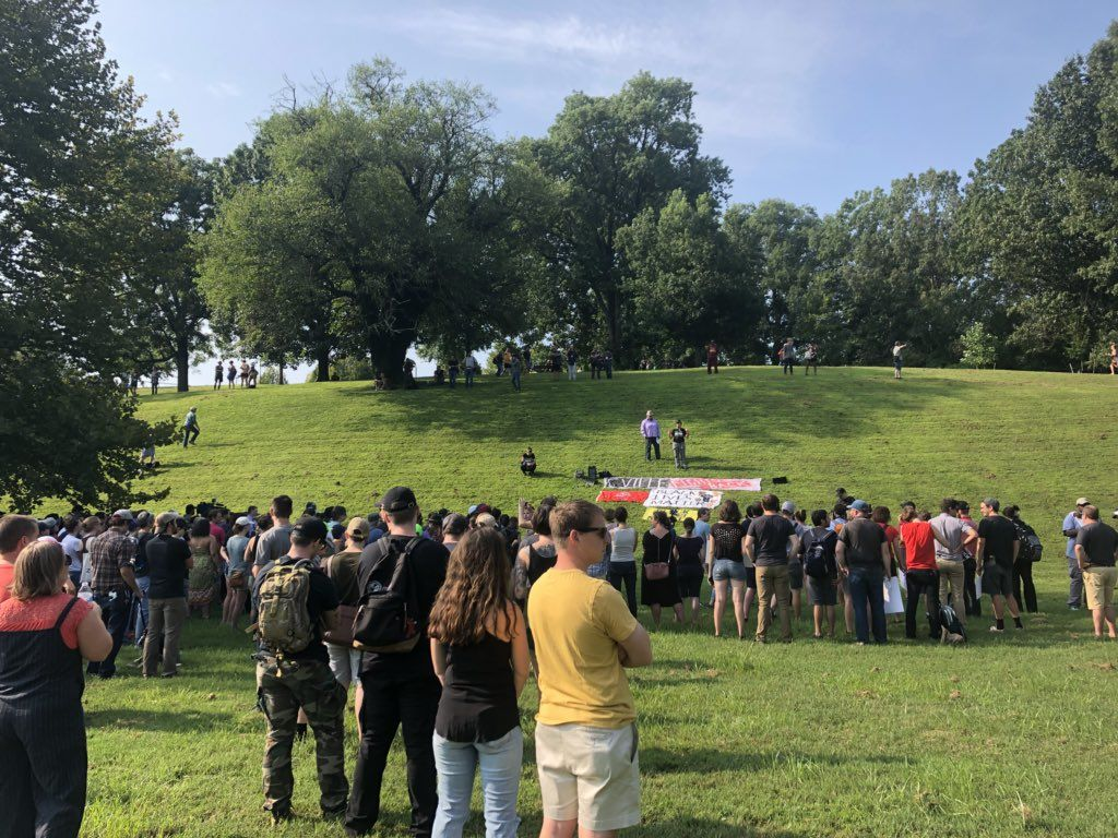 "At a rally in Booker T. Washington Park in Charlottesville, Virginia, a speaker says, ""This is a really big day. They may lock down our city, but they will never lock down our fight."" (WTOP/Max Smith)"