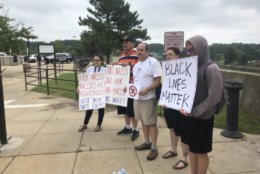Counterprotesters gather at the Vienna Metro station before Unite the Right 2 participants arrive Sunday afternoon. (WTOP/Max Smith)