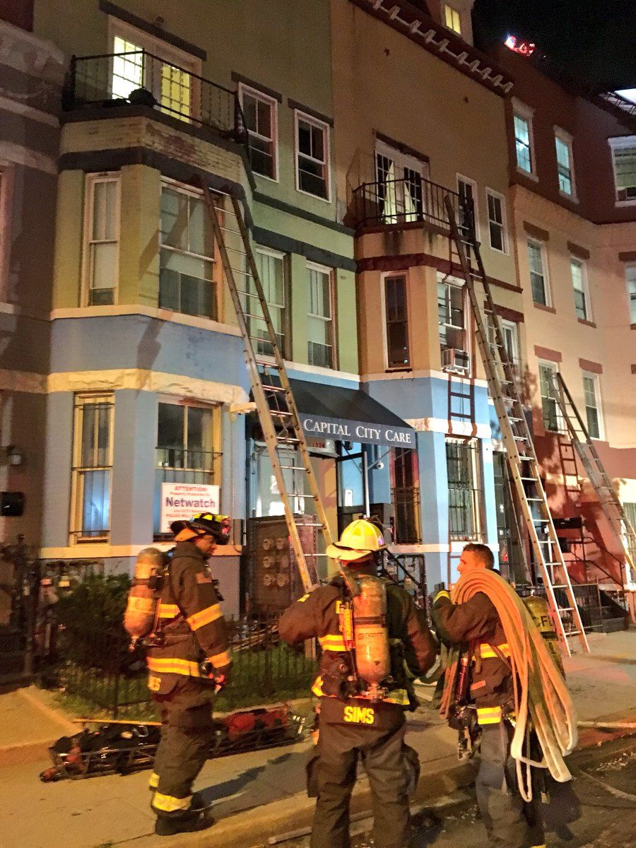 Firefighters were able to confine the fire to the roof decks and rooftop storage structures, preventing the fire from moving downward. (Courtesy DC Fire and EMS)